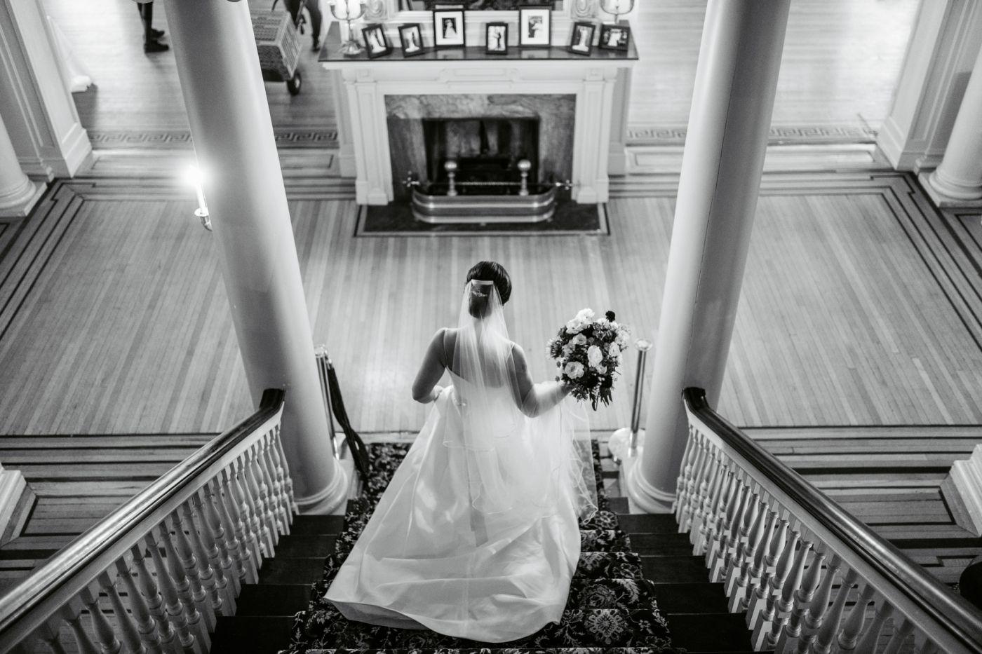 Bride on the steps at Glen Foerd Mansion