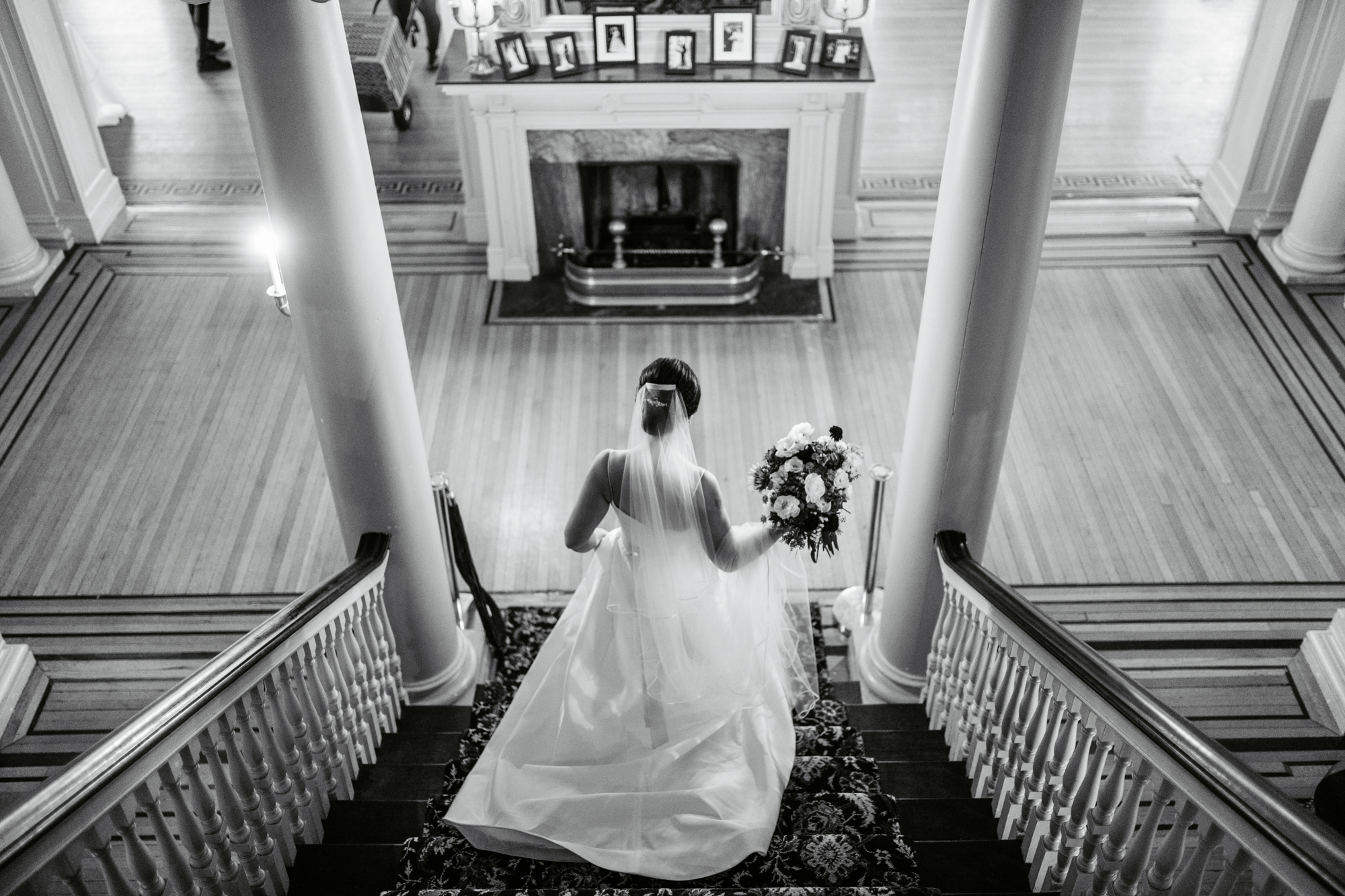 Bride on the steps at Glen Foerd Mansion