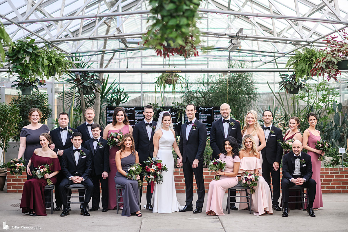 Bridal party portrait inside the Horticulture Center in Fairmount Park