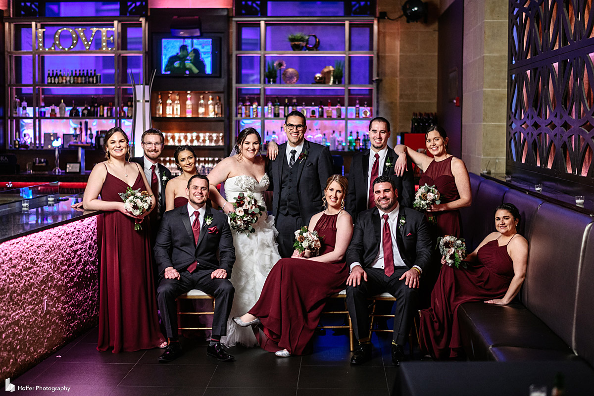Bridal party portrait next to bar area at Union Trust in Philadelphia