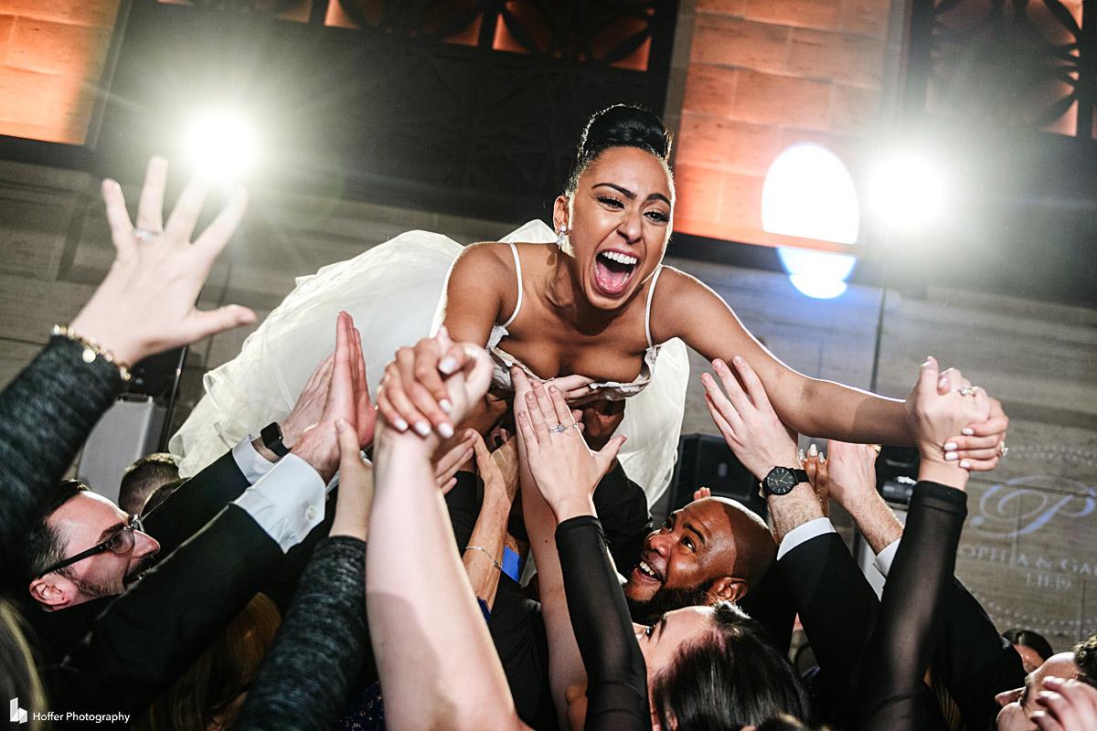 Bride crowd surfing during reception at Union Trust wedding